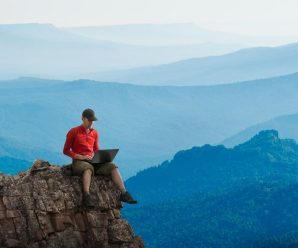 a blogger on top of a mountain